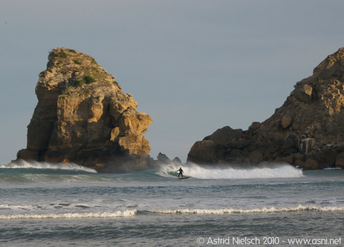 photo: Surfer at Castle Point